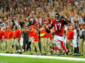 Devin Hester high-stepping into the end zone, in honor of the great Deion Sanders, on his record breaking return TD against the Bucs.